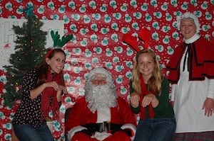 students with Santa and Christmas tree