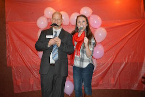 student with Provost at Special Olympics Valentine's Dance